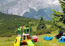 Toys for kids ouside the Bait del Germano in Paganella. Let�s have fun!
