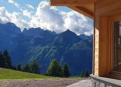 Sun terrace and view on the Dolomites, relaxing into the wild