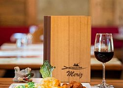 Wine tasting and gourmet food at Meriz, the alpine mountain hut in Paganella